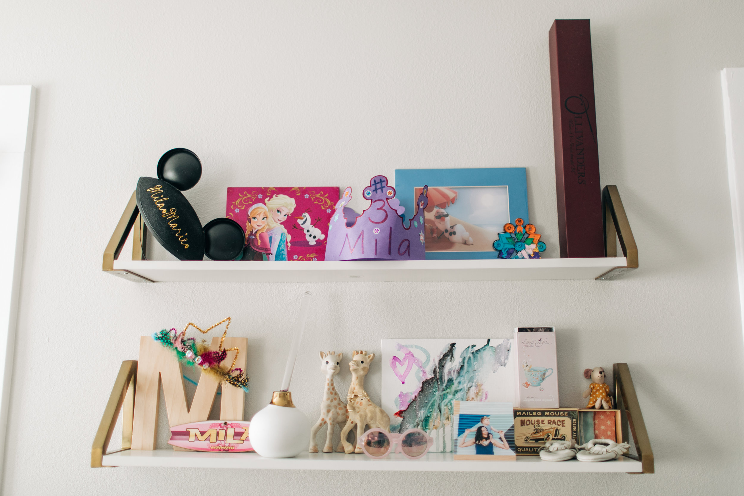 These are Mila's shelves that are hung above her dress up area. It has changed a ton since her nursery days.