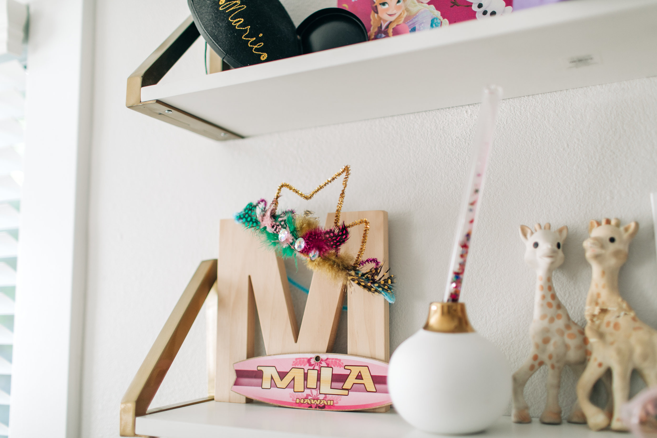 That pipe cleaner crown was from a craft shoot we did for our blog last year. The surfboard Mila name tag was a gift from her Aunt.