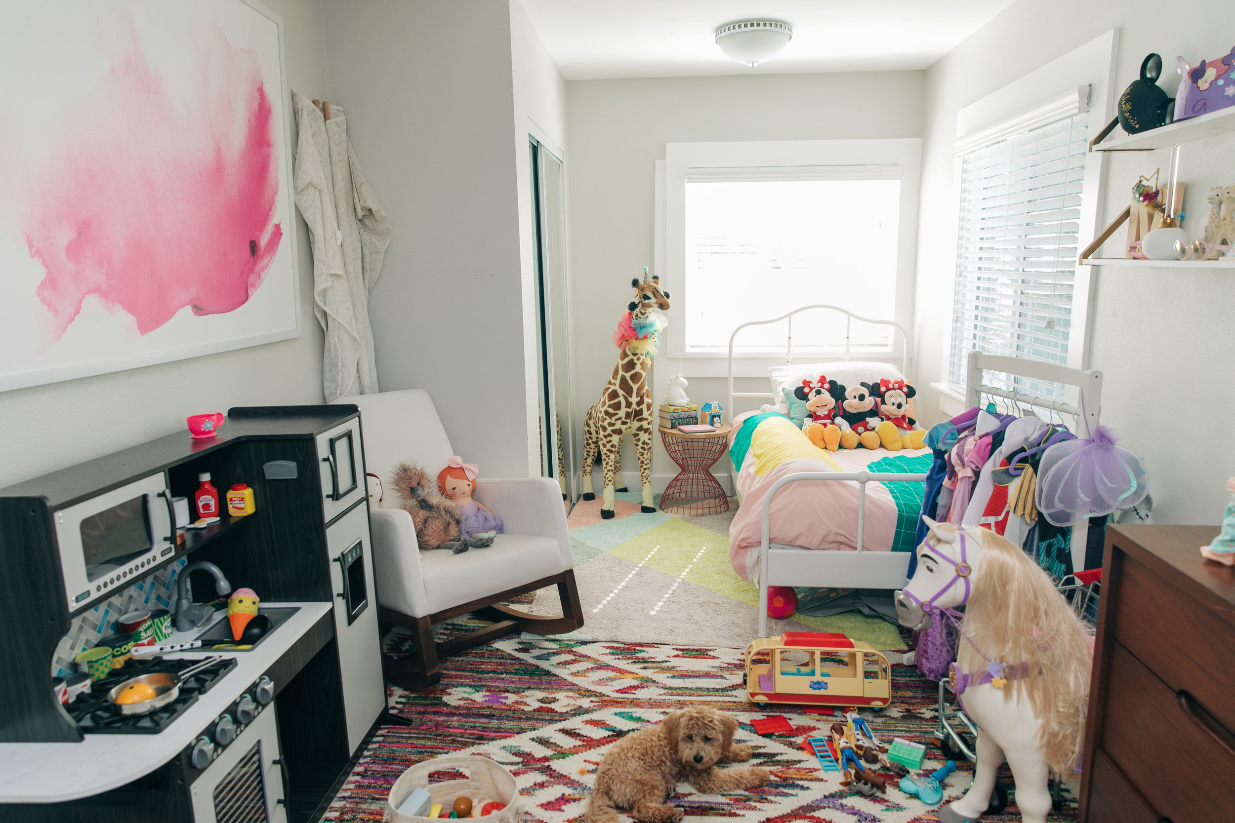 Here you can see to the left is the large art print that used to hang above Mila's crib. To the right you can see just the corner of Mila's dresser. I spy Marley too hanging out!