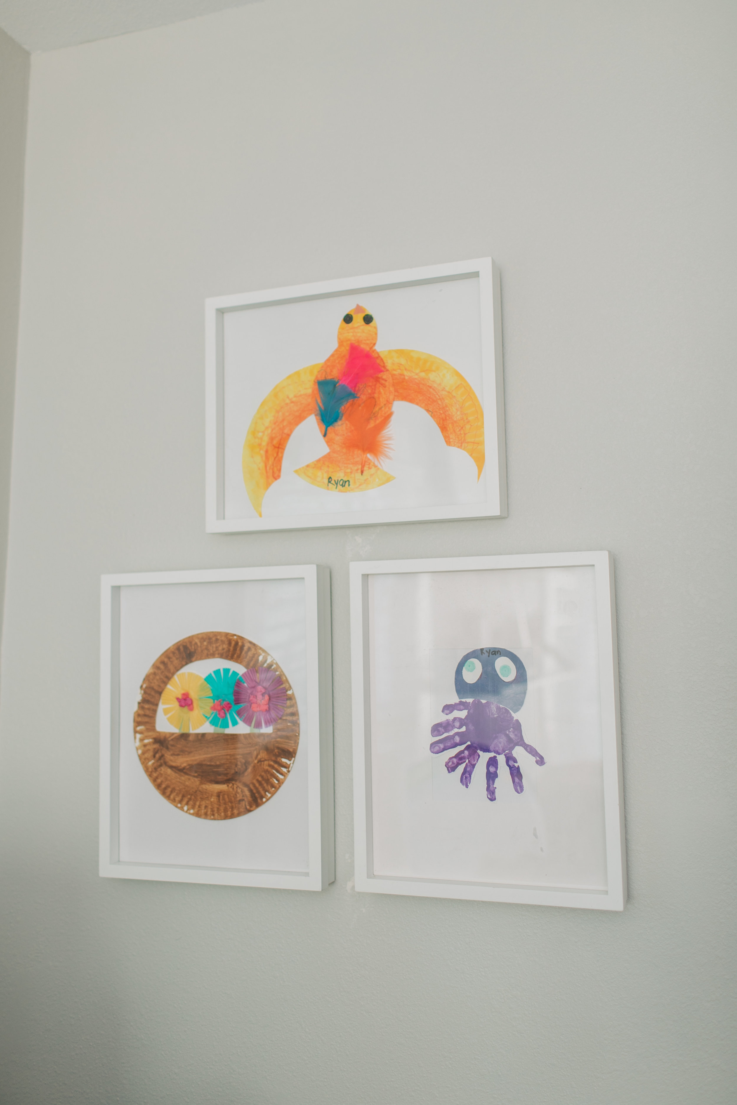 We also have some of Ryan's artwork framed for Mila's nursery because I loved the thought of his artwork in her room. They are still hanging in there and she loves them. I used to think that Ryan made these all the while knowing he was making them for his little sister. Now Mila says Ryan made those for her so, I have to believe he did.  Again, if Mila ever wanted to remove them I would. But for now she seems to enjoy the little pieces of her big brother within her space.