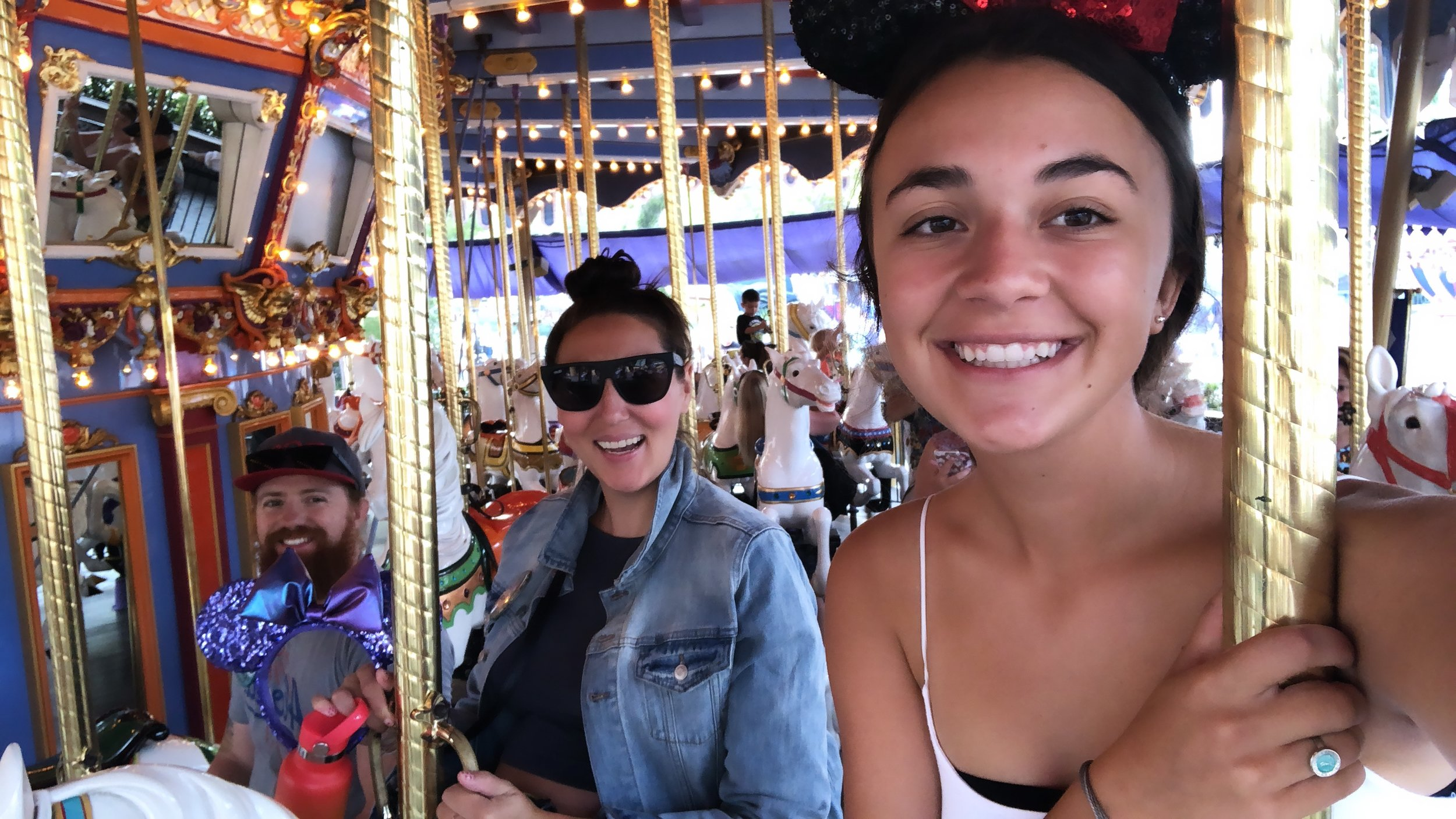 My baby sister and husband riding the carousel together!