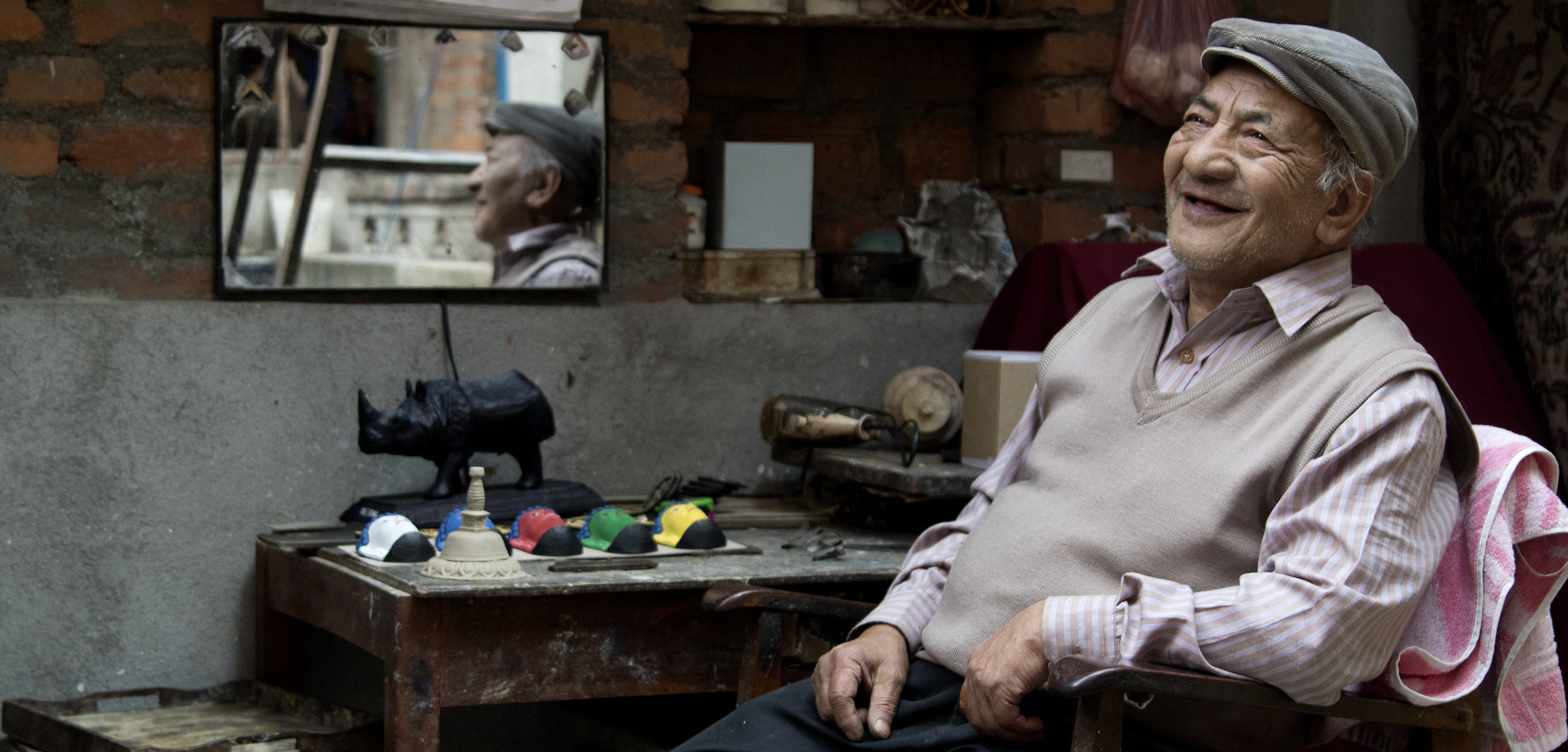 70 year old Aji's maker Juju Ratna Tamrakar in his terrace workshop. Photo by Keshav Thapa.