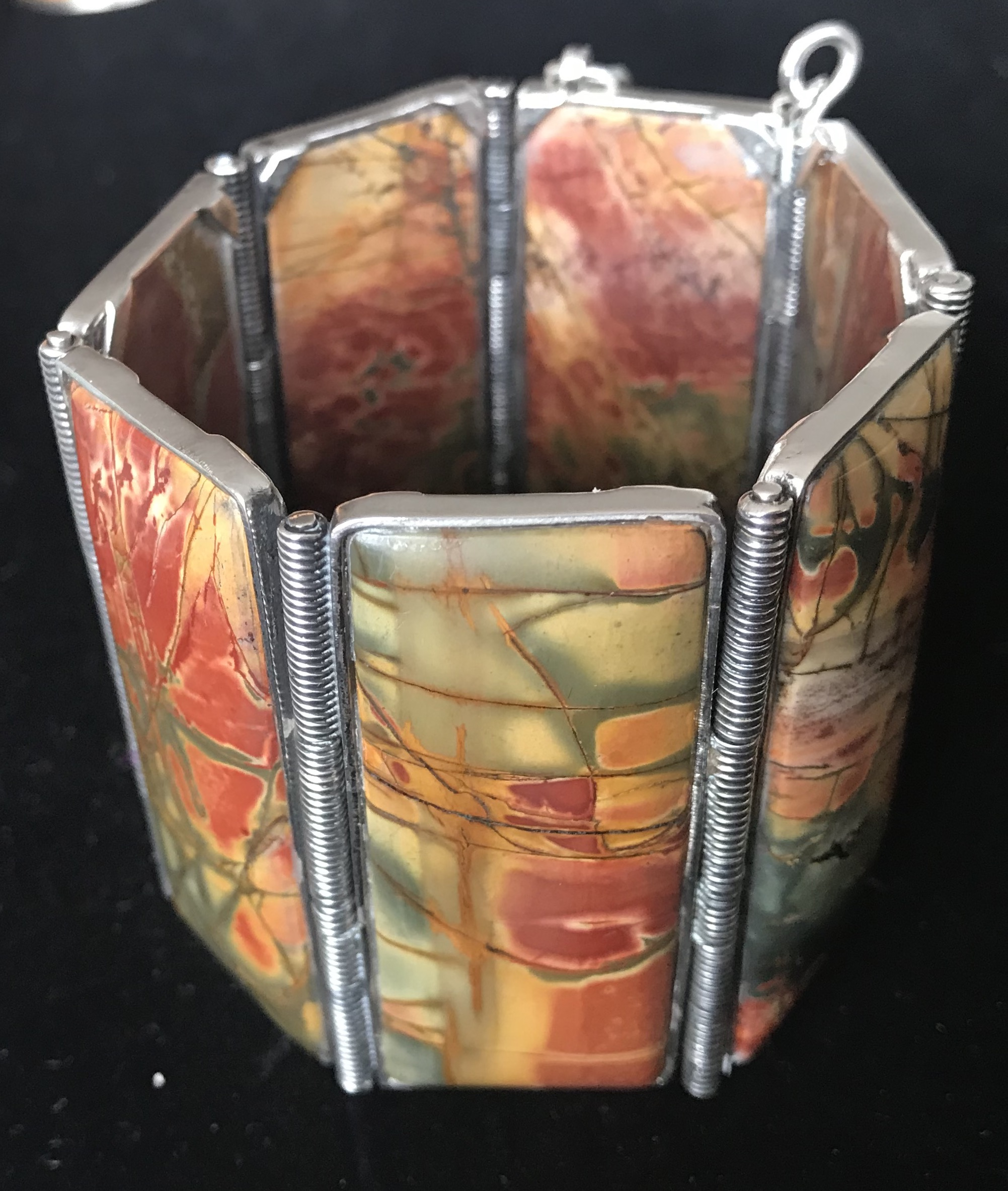 """Lois Sherr Dubin """"QueenBead"""" - Large beads of borosilicate (hard) glass are lamp-worked, blown, surface decorated and heat and gravity shaped. Small spacer beads of borosilicate and soda-line (soft) glass are lamp worked and surface decorated. No two beads are identical, all are handmade and one-of-a-kind. Both the necklaces and the single beads on an adjustable leather cord can be worn separately or layered in varied combinations.The necklaces have been designed and assembled by Lois Sherr Dubin (QueenBead) of New York. A museum curator and author, Dubin has curated numerous exhibitions and written many books on adornment. Her lifelong love and research led to her best-selling The History of Beads: From 30,000 B.C. to the Present (Abrams, 1997; reissued in paperback in 2004 and reissued and updated November 2009 as The History of Beads: 100,000 to the Present).This year Dubin introduced the QB line of beautiful jasper necklaces and bracelets. Due to the natural properties of the stone each piece is unique. Stones are cut and assembled into pieces that can be worn alone or layered.To visit the full collection and learn more about this designer, visit www.loissherrdubin.com"""