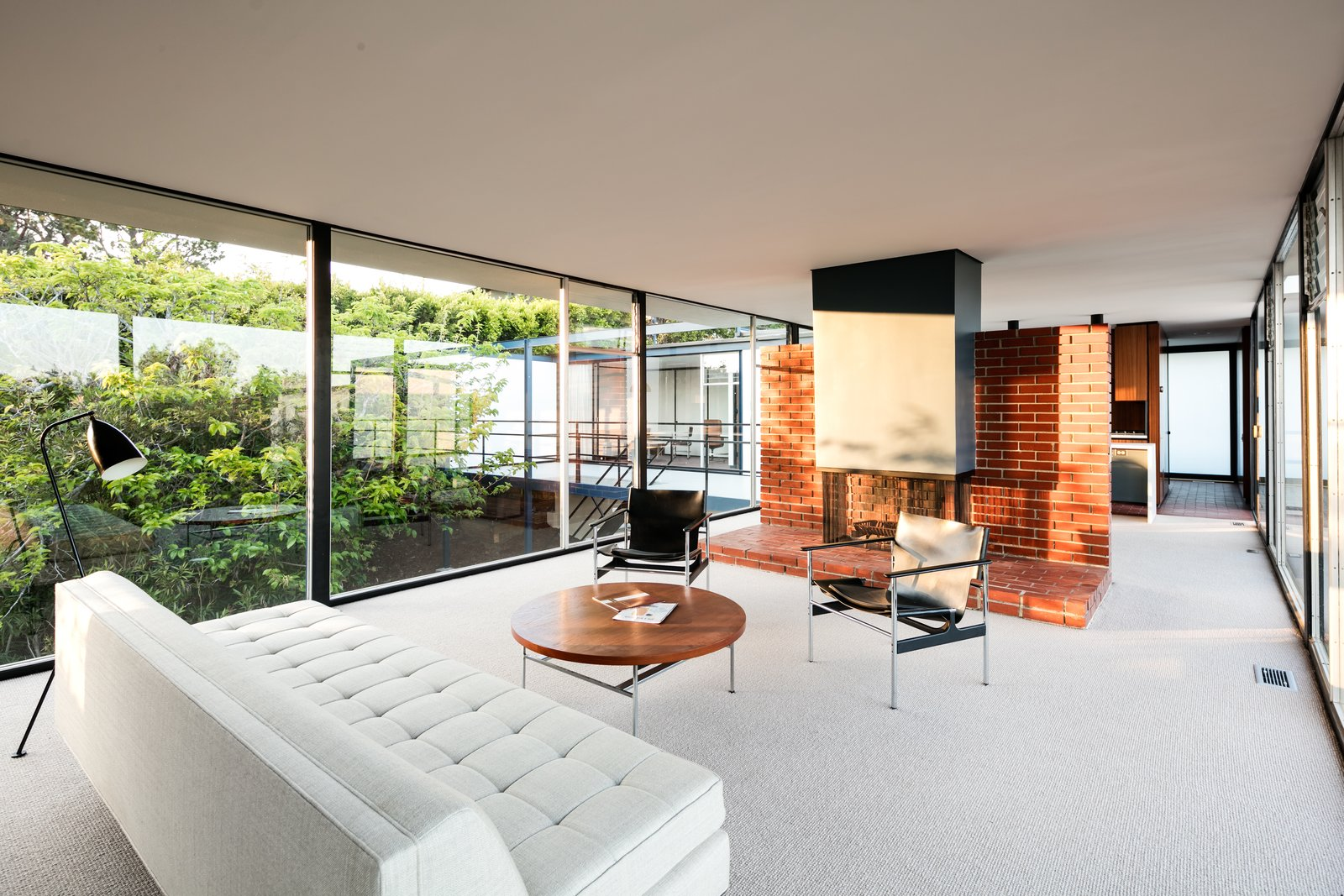 A look at the open living plan. Note the fireplace is set in the center of the space against a brick dividing wall.