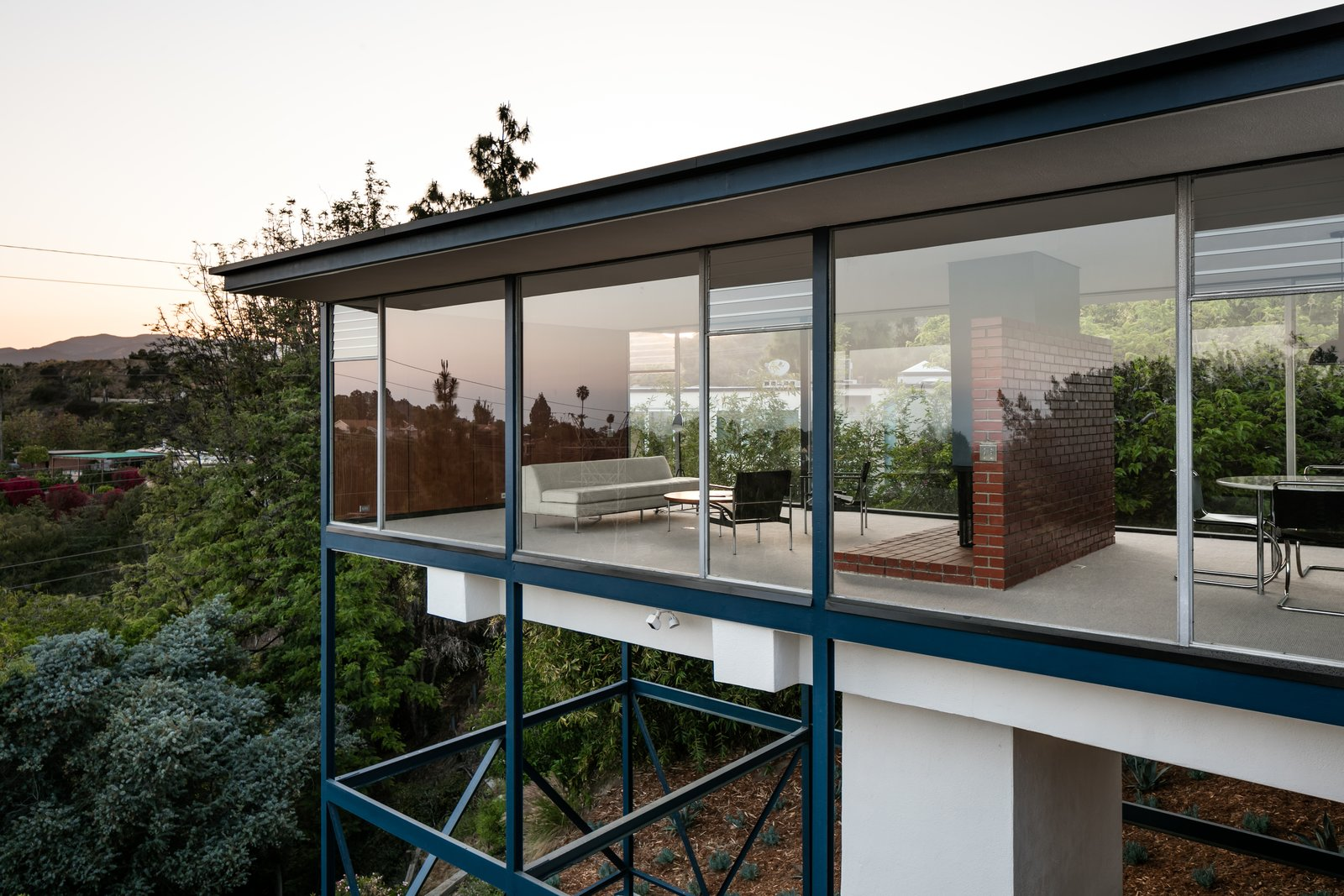 """""""At night, the Smith House appears to float like a glass box in space."""""""