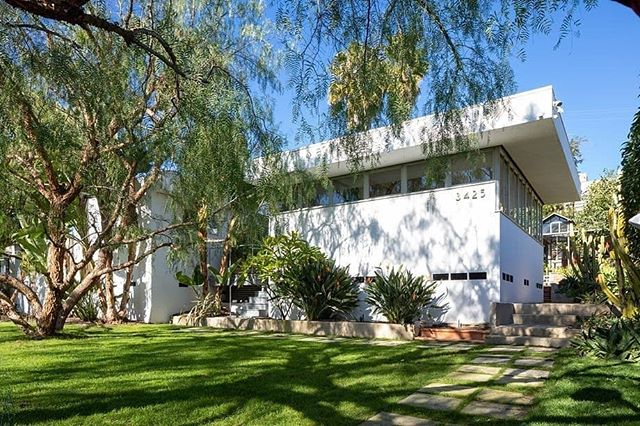 "Currently on the market in L.A. for 1.985 M - The storied Lukens house in the Jefferson Park area of West Adams - an important example of the early work of influential modernist architect Raphael Soriano. Built in 1940 for Glen Lukens, a ceramist, USC professor, and co-founder of Arts and Architecture magazine, the International Modern-style residence narrowly avoided demolition thanks to the concerted efforts of local preservationists who secured Historic-Cultural Monument status for the property in 2007. The house was later purchased by a preservation-minded buyer who sensitively rehabed the home while restoring and replacing historic elements, utilizing Soriano's original drawings and vintage photographs by Julius Shulman as reference. Measuring 1,491 sq ft, the home contains three bedrooms +  two baths and features ribbon band steel frame windows, hardwood and tile floors, built-in furniture and shelving and a living room fireplace. It comes with a glass greenhouse originally built in 1908, that has been restored and re-purposed as a dazzling dining pavilion in a lush and peaceful garden. To add to the property's pedigree, Frank Gehry credits a visit to the house as the inspiration for his career in architecture, stating ""Glen (Lukens) changed the course of my life. He was building a house with architect Raphael Soriano, and he had a feeling that I might like to see the process, so he dragged me over there one day. Soriano was there, wearing an all-black outfit with a black beret, giving directions in his accented English and telling men how to put up steel. I really got into it. The next day Glen called me into his office. He said ""You know I have this hunch. Will you go along with me?"" I said ""Whatever you say, boss."" He signed me up (and paid for) a night school architecture class. The class was the first time I did something that got people saying, ""Hey there's something going on here."" They liked what I did and I enjoyed it, and the school skipped me into the second year."" #glenlukens #raphaelsoriano #frankgehry #westadams #architecture #midcenturyhome #midcenturyarchitecture #midcenturymodern #design #realestate #collectiblehouse"