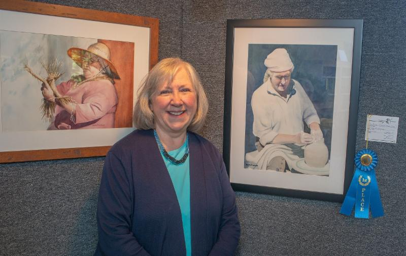 "Donna Finnegan won Spotlight's first place for her watercolor ""The Potter"""