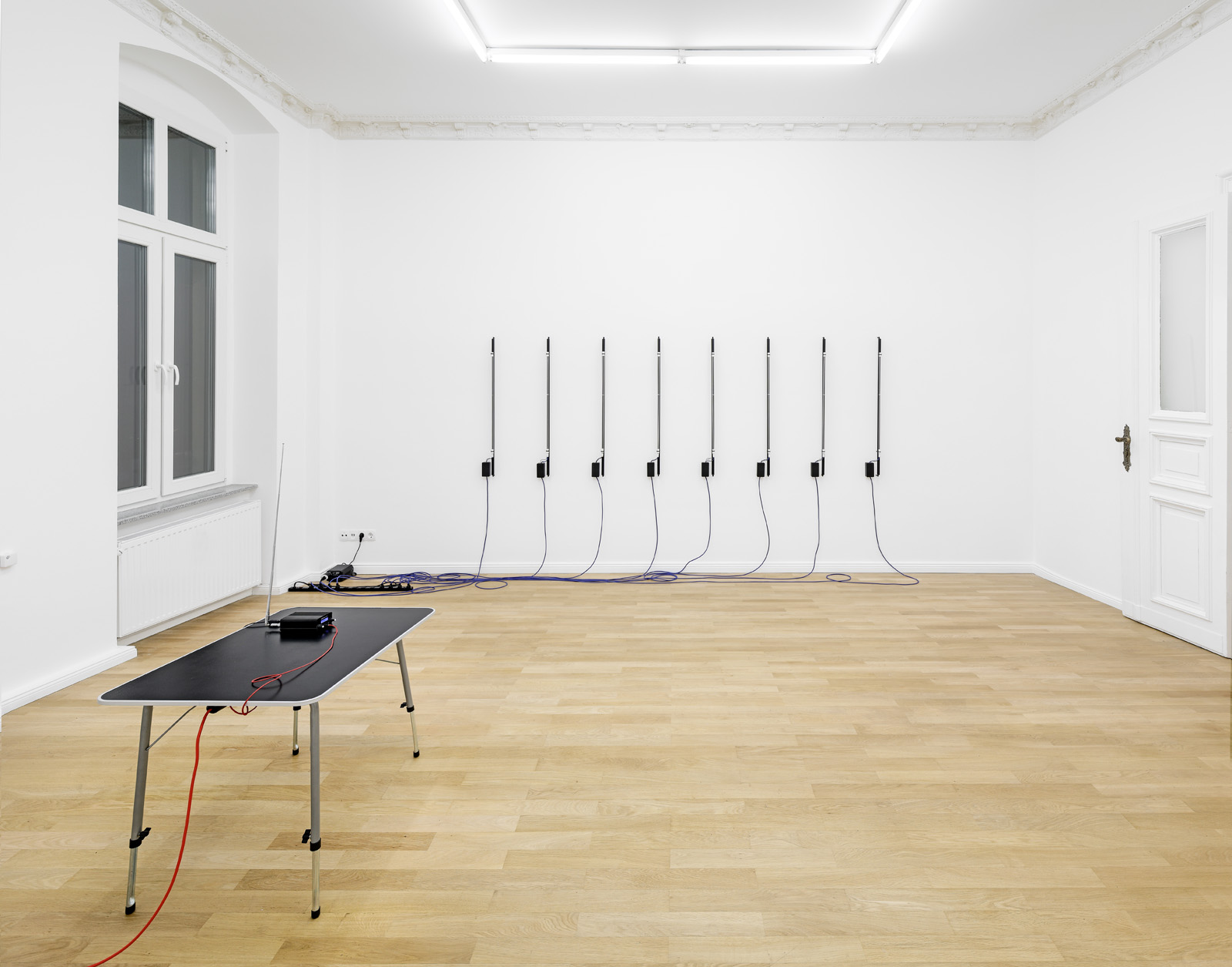 Installation view, Christopher Aque,  Red-blooded, White-skinned, and the Blues  Foreground:  Transmission , 2018 (FM transmitter); Background:  Erasure (en masse) , 2018