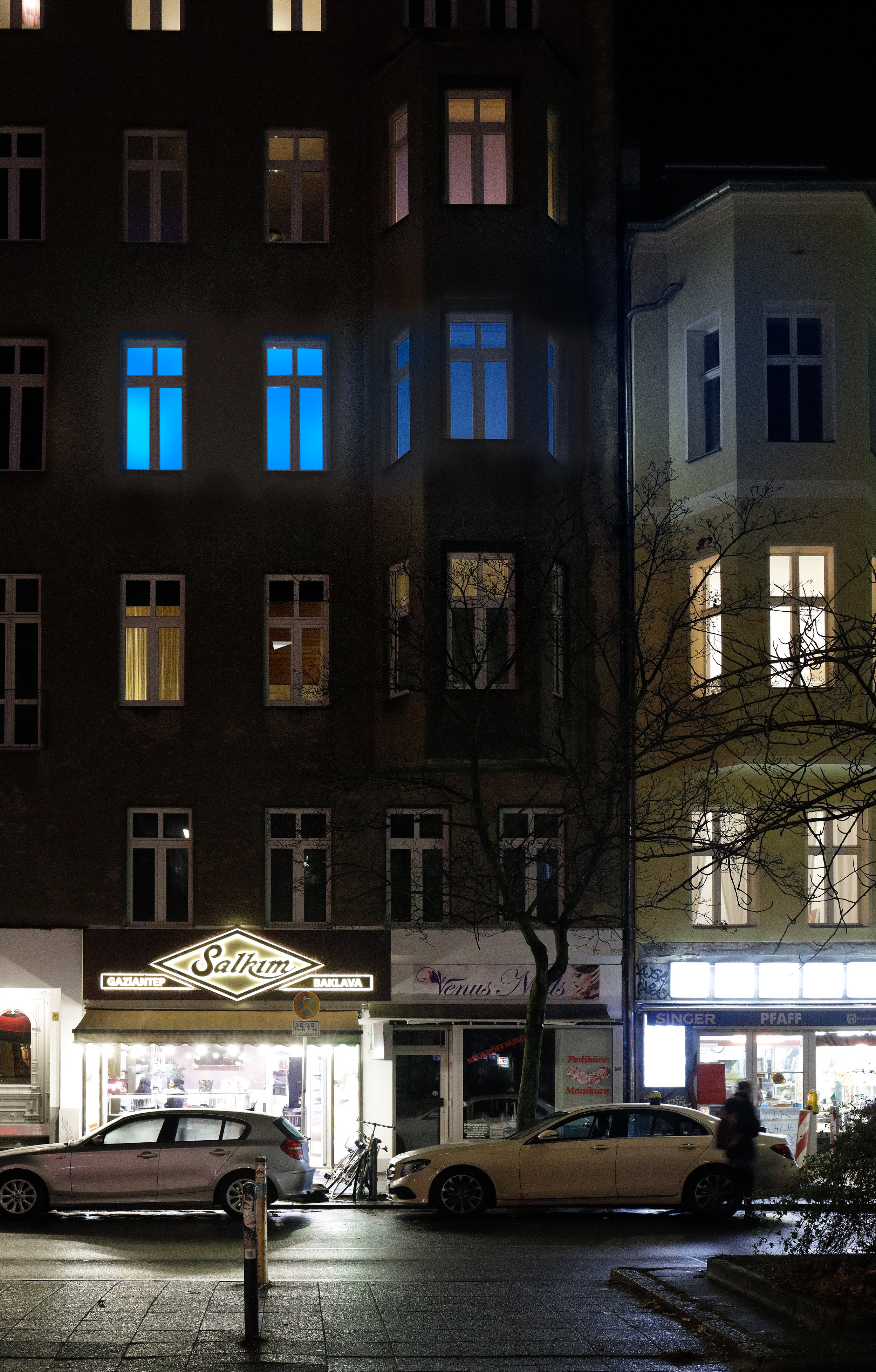 Installation view, Christopher Aque,  Red-blooded, White-skinned, and the Blues Erasure (en masse) , 2018 (lights activated as seen from street)