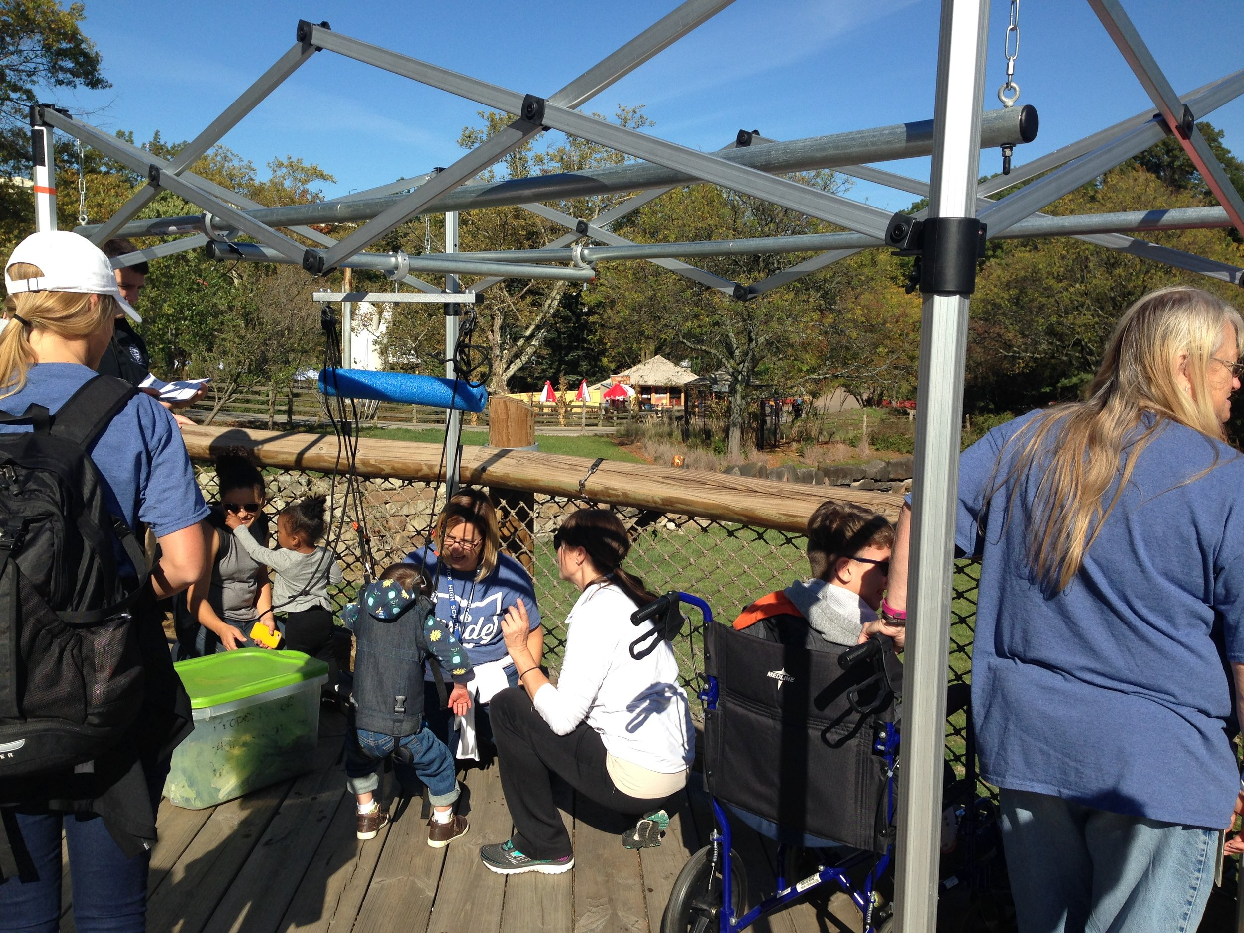 Our active volunteers and children attendees feeding Giraffes at the Cleveland Metroparks Zoo