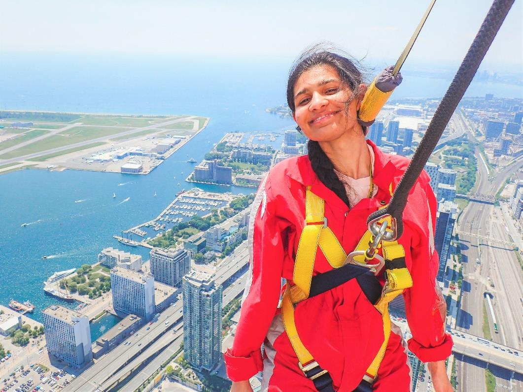 """""""Over the summer I had many adventures exploring eastern Canada, my favorite being the CN Tower EdgeWalk."""" I was in Oakville, Ontario working with Siemens as part of their SCETA (Siemens Canada Engineering and Technology Academy) program. During this program I was trained on different aspects of engineering – Industry Application, Hands On, and Mechatronics Systems. In addition, strengthening more professional competence skills – Communication, Business, Leadership and Collaborative Teams. This program provides me with the skills to start my career at Siemens while making real what matters!"""" - Simran Sarai"""