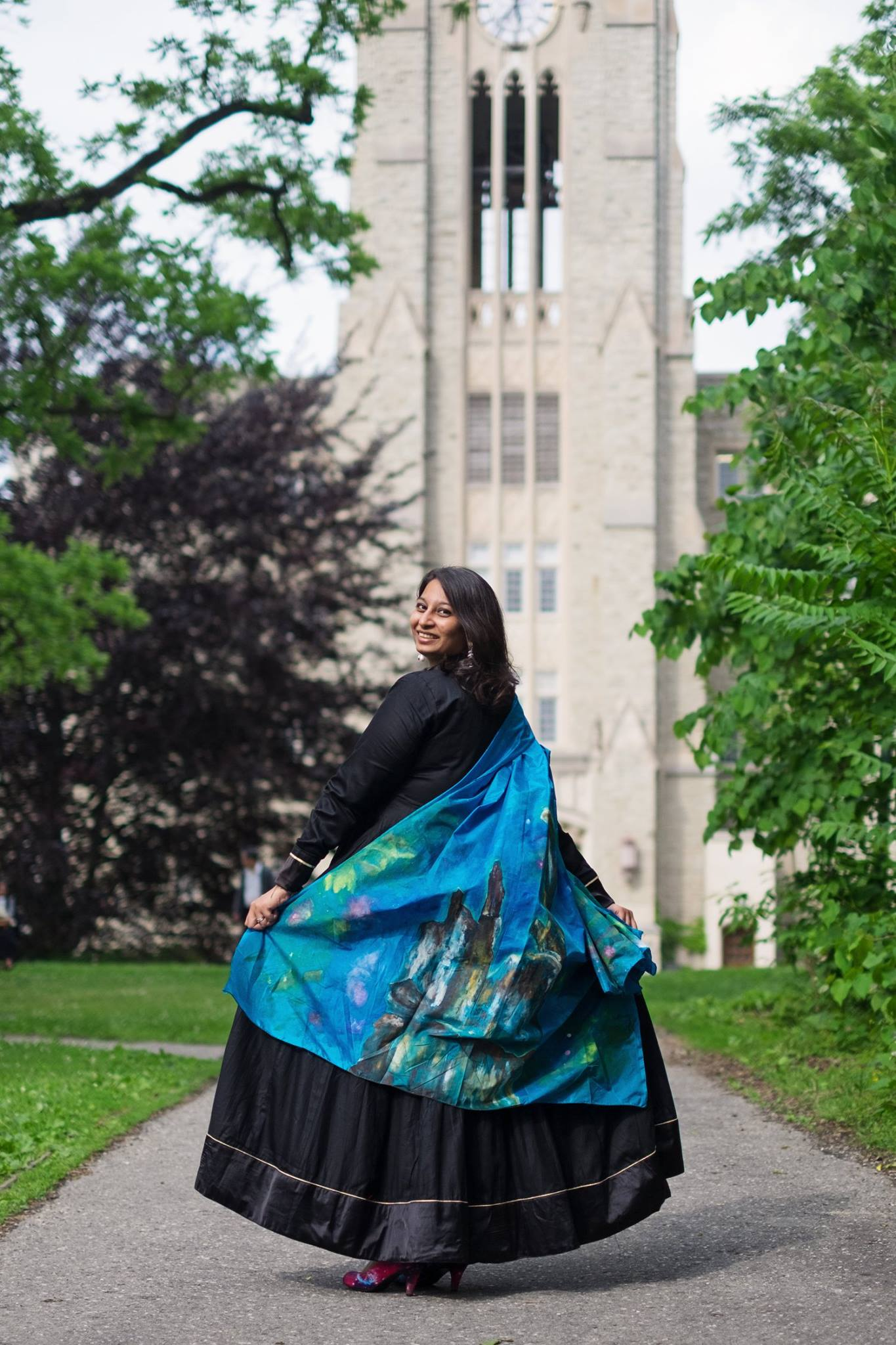 Parshati loves communicating her passion for space in several ways. In this photo, she is wearing a custom designed scarf for her graduation ceremony. The scarf was an artist's rendition of stellar nurseries or star forming regions - the topic of Parshati's PhD thesis.