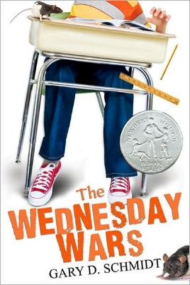 The Wednesday Wars  for Middle Readers  Meet Holling Hoodhood, a seventh-grader at Camillo Junior High, who must spend Wednesday afternoons with his teacher, Mrs. Baker, while the rest of the class has religious instruction. Mrs. Baker doesn't like Holling—he's sure of it. Why else would she make him read the plays of William Shakespeare outside class? But everyone has bigger things to worry about, like Vietnam. His father wants Holling and his sister to be on their best behavior: the success of his business depends on it. But how can Holling stay out of trouble when he has so much to contend with? A bully demanding cream puffs; angry rats; and a baseball hero signing autographs the very same night Holling has to appear in a play in yellow tights! As fate sneaks up on him again and again, Holling finds Motivation—the Big M—in the most unexpected places and musters up the courage to embrace his destiny, in spite of himself.