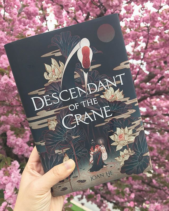 the flowers are in bloom, Descendant of the Crane is an AMAZING book, and life's okay. ✨ ✨ ✨ #bookstagram #yabooks #dotc #descendantofthecrane #booksandflowers