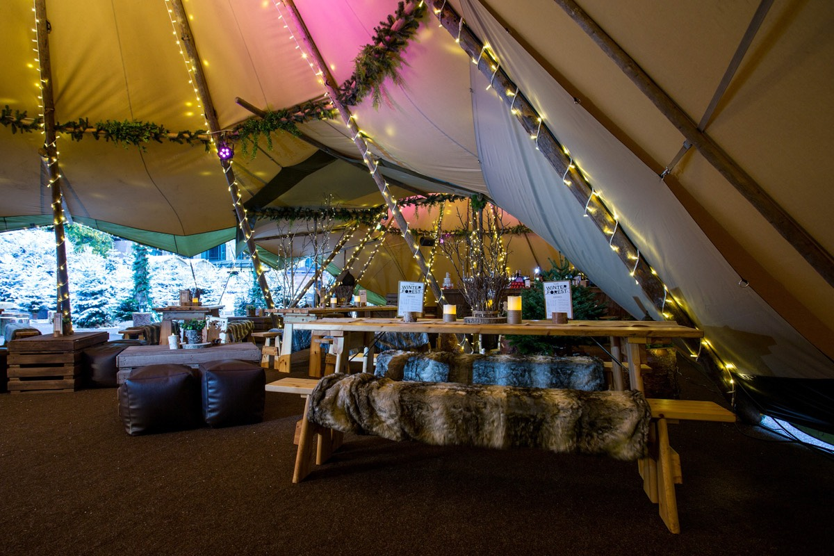 Even in winter our giant tipi tent marquees make a perfect space and can come with heating and wooden doors, ideal for a winter wedding our corporate event.