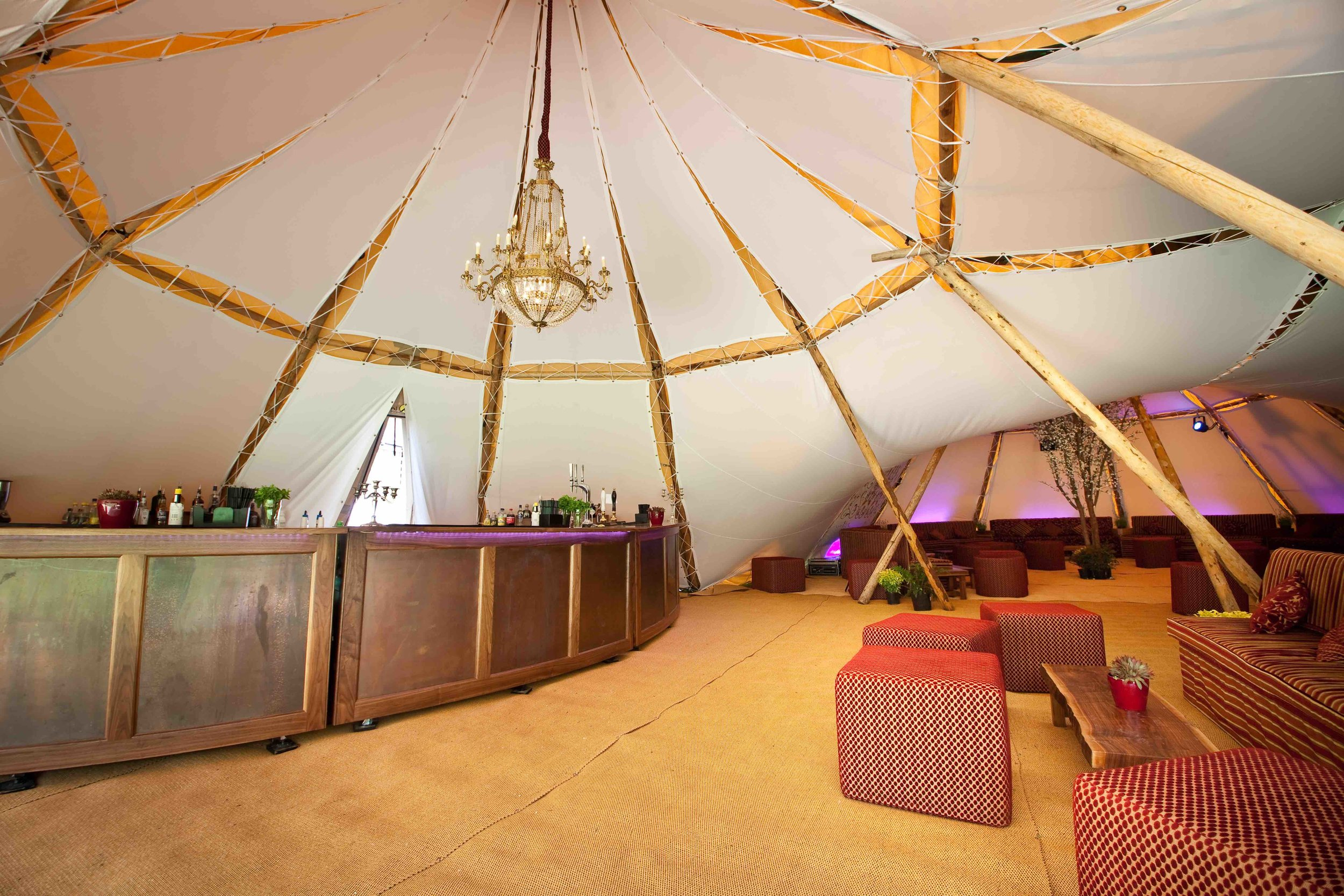 Our wooden bars can be hired alongside our beautiful tipis for your UK event, whether it's a wedding, party, corporate event or festival. Our decor and interiors include solid wooden furniture, beautiful tent linings, chandeliers and lighting.