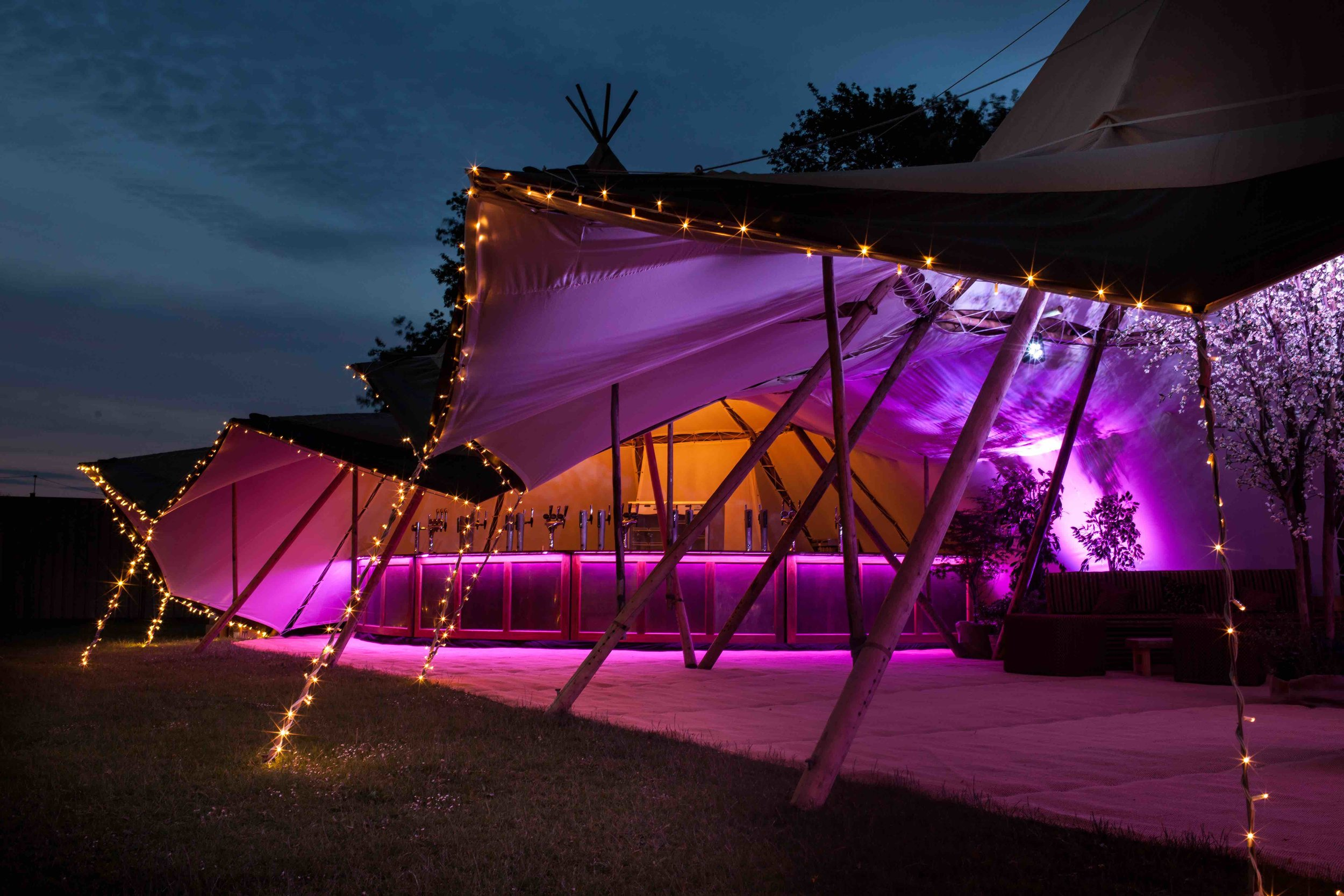 We offer beautiful event lighting for your wedding, party, corporate event or festival, be it fairy lights, floodlights or giant flower lights, which accompany our giant tipi tents perfectly.