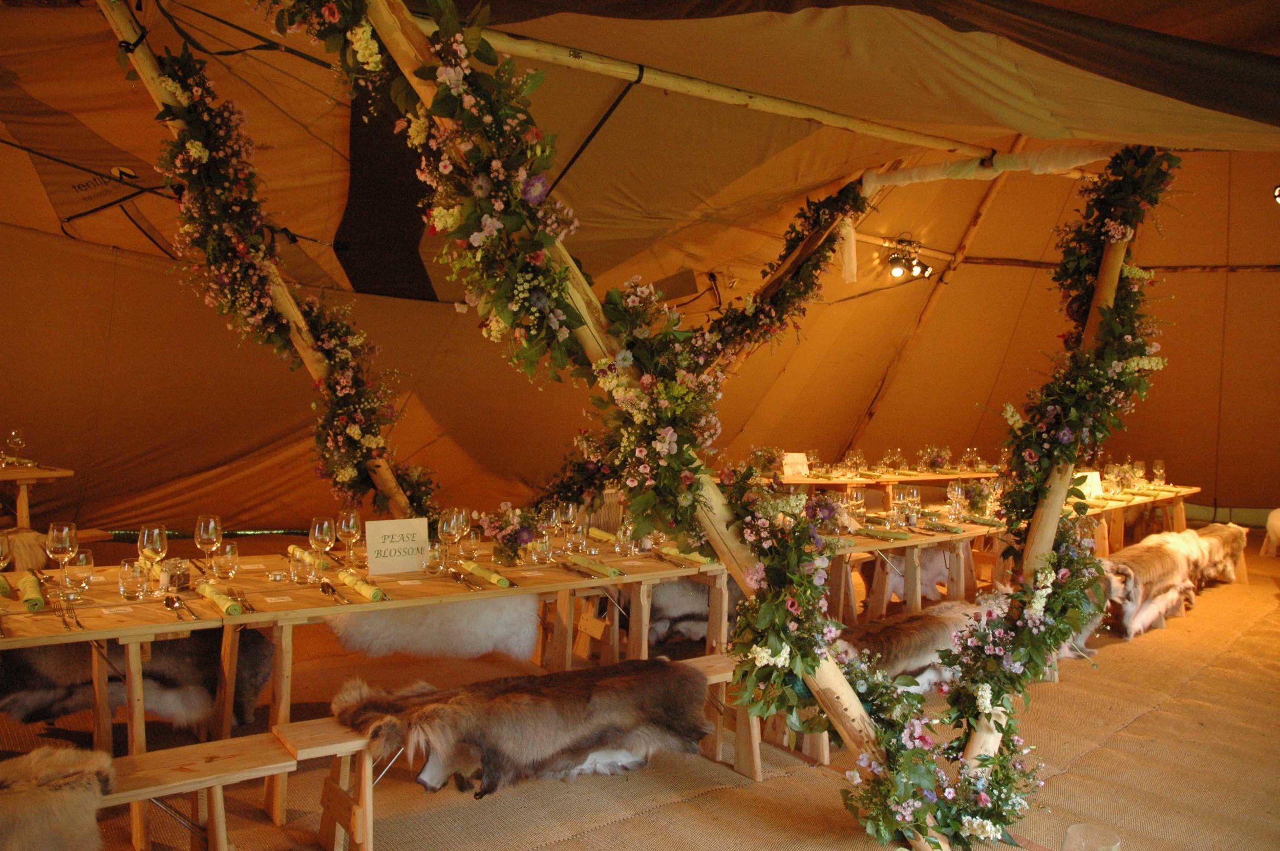 Dining tables and chairs for your wedding, party or corporate event can be hired as part of your package with our giant tipi tents, including all linen.