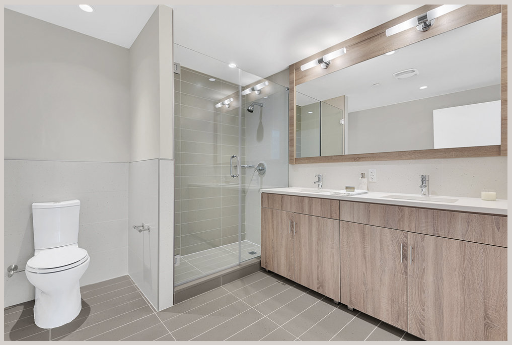 Spa-like bathrooms are outfitted with premium Kohler fixtures and radiant heated floors.