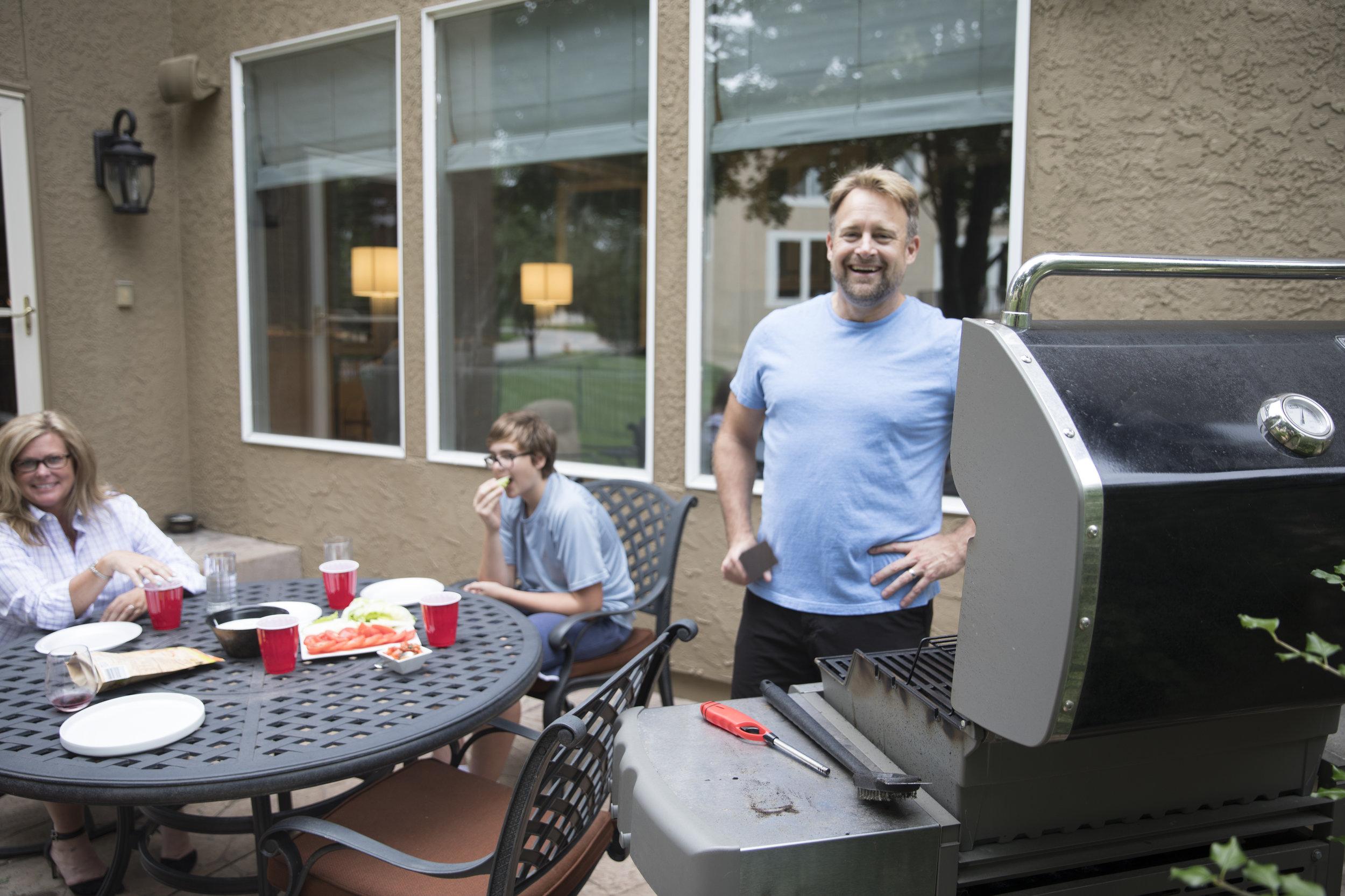 Trevor grilling for the family