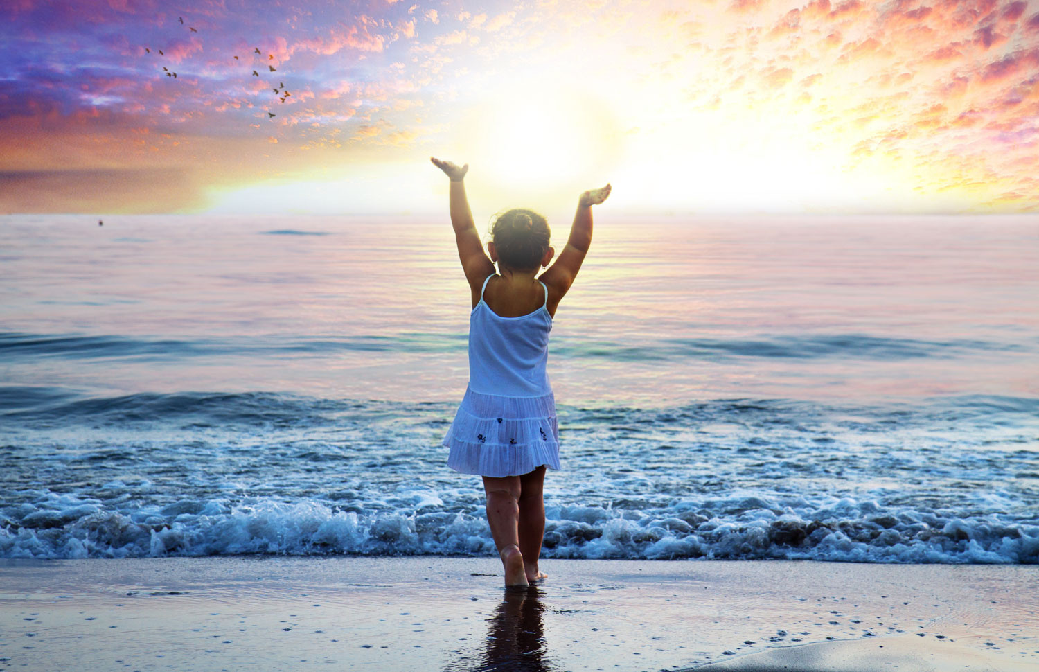 janette - little girl with hands raised at ocean.jpg