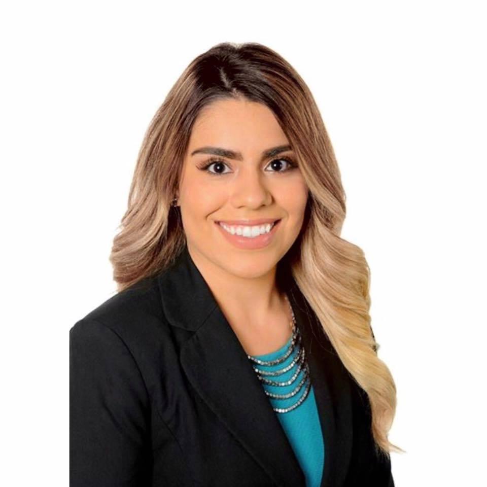 Andrea Espinosa , Harmon Travel