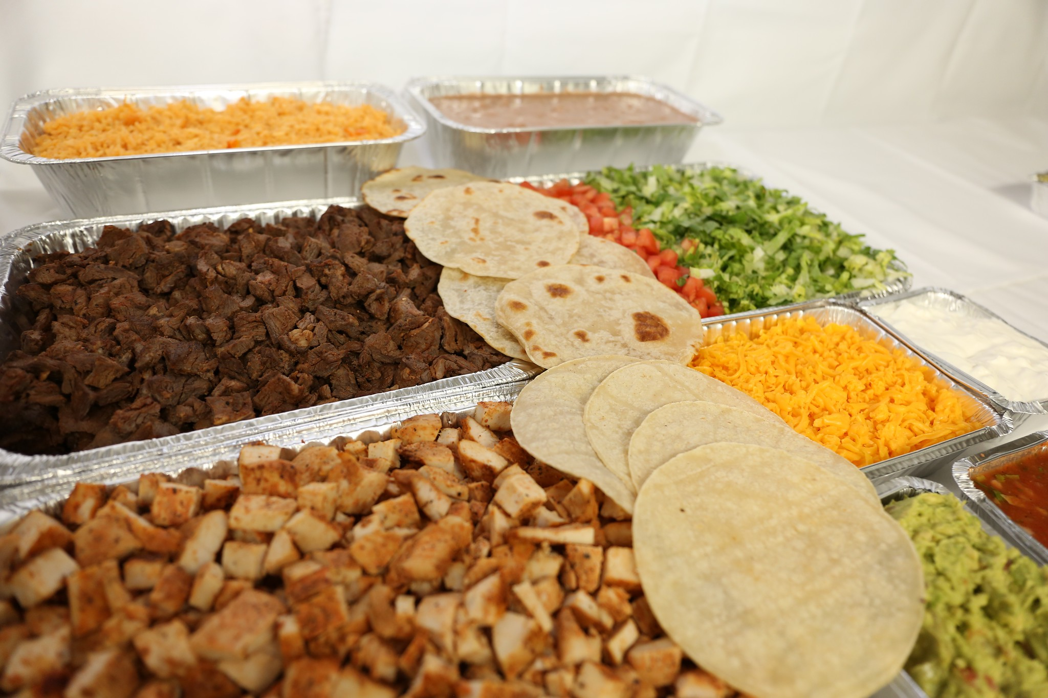 Fajita Catered Spread with Tortillas and Toppings
