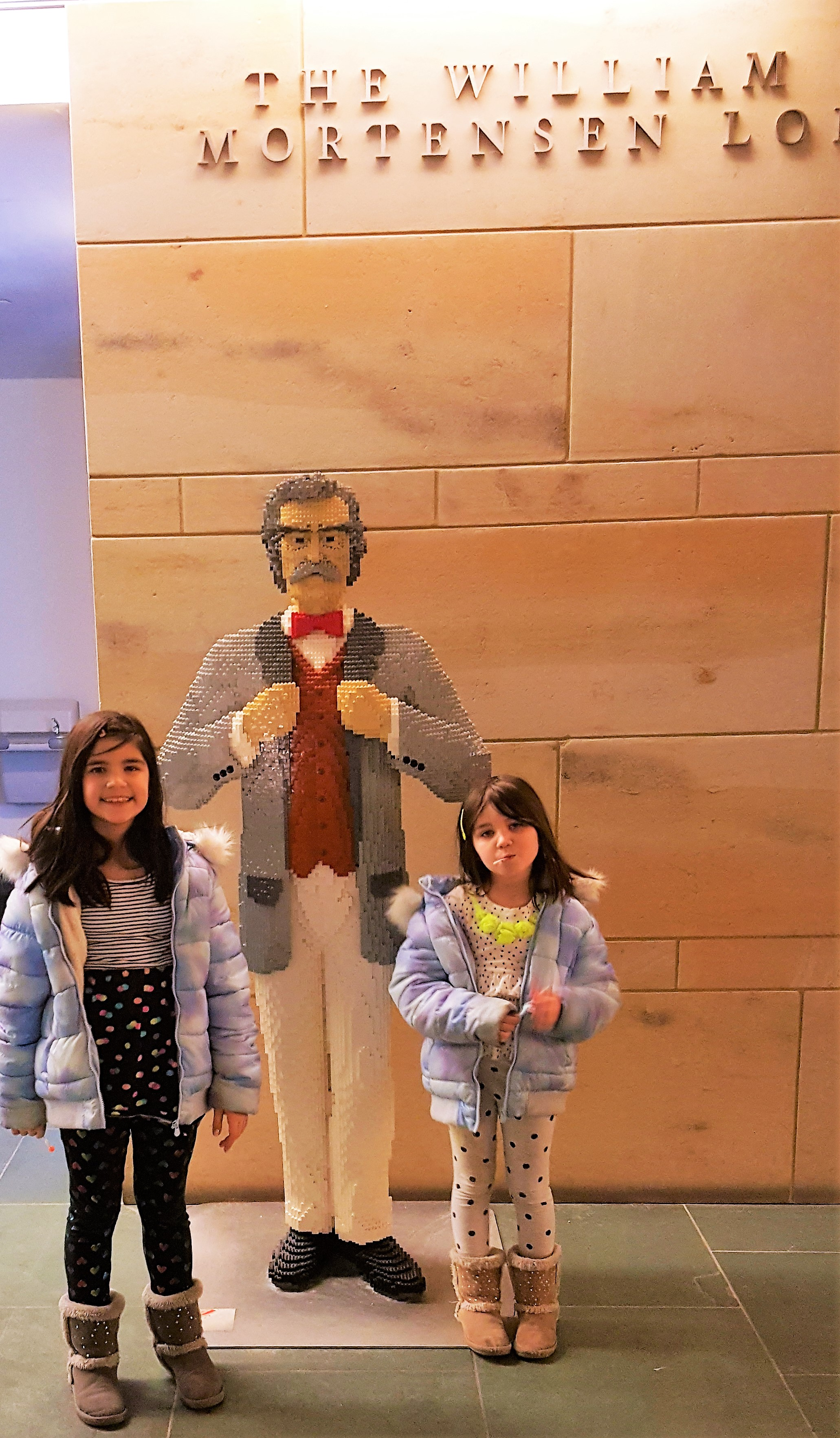 A Mark Twain, made entirely of Legos, greets the girls at the entrance.