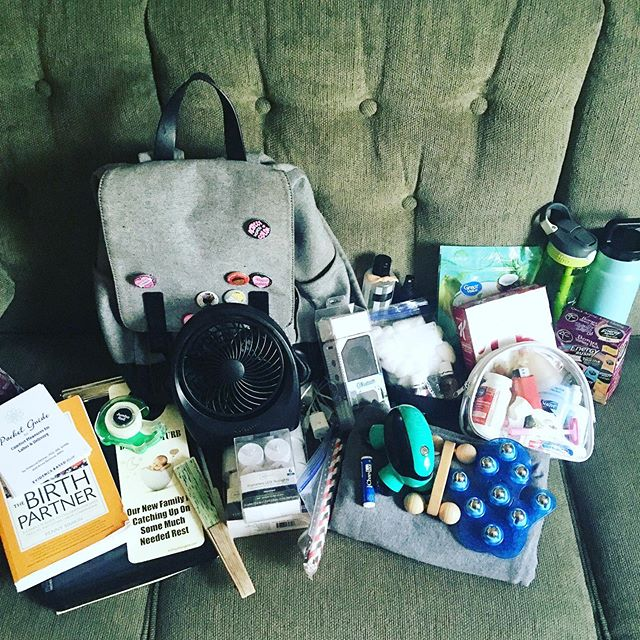Gearing up for an expected long labor! So, What's In My Doula Bag? 👇🏼 -Paperwork -Birth Literature -Door Sign -Scotch Tape -Portable Fans -Flameless Candles -Straws -Bluetooth Speaker -Charging Cables -Chapstick -Rebozo -Massage Tools -Essential Oils -Cotton Balls -High Protein Snacks -Personal Care Items -A Bottle of Cold Water -A Thermos of Strong Coffee -Camera (not pictured)  The bag varies a little Birth to Birth, But this is a pretty good idea of what lies within our Mary Poppins bag of wonder! ✨💗🤰🏽🤱🏻💗✨