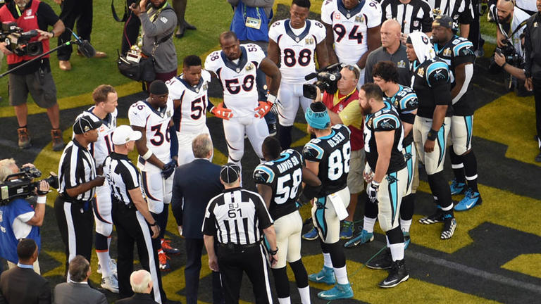 Kayvon with his fellow captains during the coin toss in Super Bowl 50