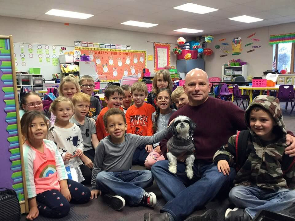 Michael and Snoopy visit a school in Grinnell, IA in November 2017.