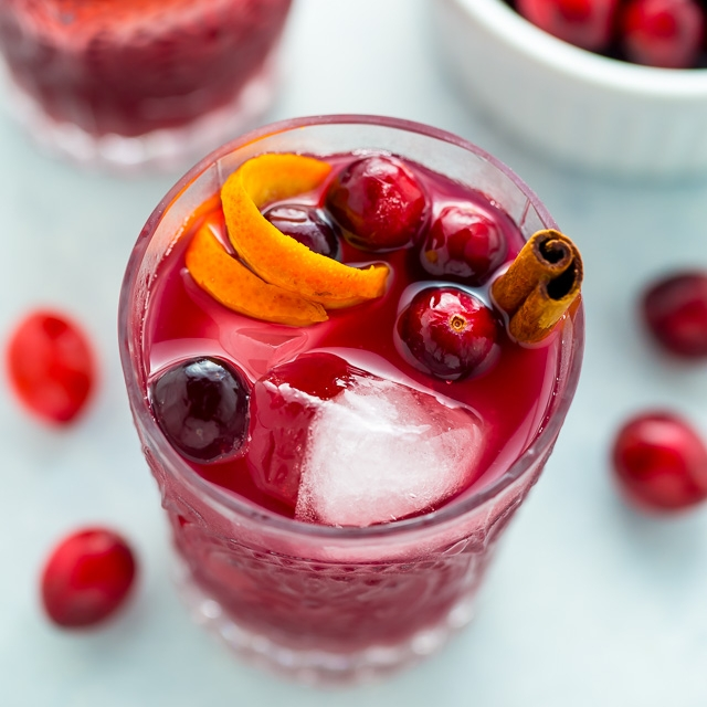 CRANBERRY CINNAMON WHISKEY SOUR - 2 cups fresh cranberries2 cups water2 cups sugar2 cinnamon sticks3/4 cup bourbon or whiskey1/2 cup lemon juice1/4 cup orange juice1/4 cup lime juiceIce cubes & cocktail shaker for mixingSee it here