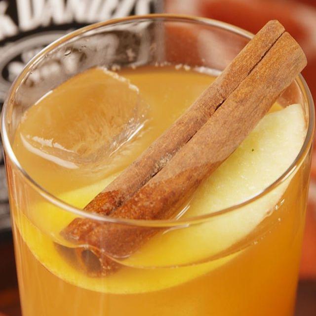 APPLE CIDER OLD FASHIONED - 1/2 c. ice2/3 c. apple cider2 oz. whiskey2 dashes Angostura bittersApple slices, for garnishCinnamon sticks, for garnishSee it here