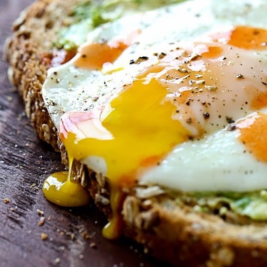 AVOCADO TOAST WITH SUNNY SIDE EGG - 1 slice whole grain bread, toasted (1.5 oz)1 oz mashed (1/4 small Haas) avocadocooking spray1 large eggkosher salt and black pepper to tastehot sauce (optional)See it here