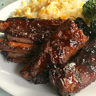 FALL OFF THE BONE BBQ RIBS - 1 (2-3 lb) rack of ribs (I use pork loin ribs)3 1/2 cups pineapple juice (reserving 1/4 cup for later)1 1/2 cups brown sugar1 (16 oz) bottle of BBQ sauce See it here