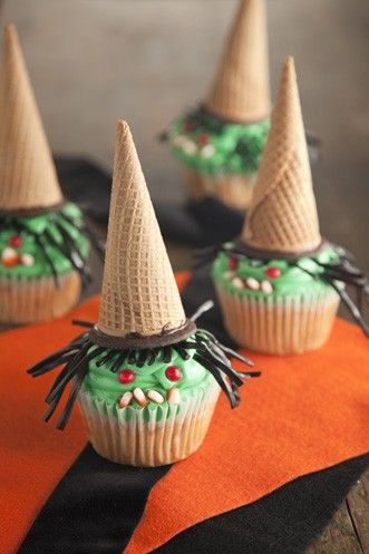 WICKED CANDY BAR CUPCAKES - Ingredients1 Egg, large2 (4 oz) bars chopped semi-sweet chocolate1 1/4 cups All purpose flour1/4 tsp Baking soda2 cups Confectioner's sugar1 Food coloring, green1/2 tsp Salt3/4 cup Sugar1/2 tsp Vanilla extract15 Chocolate wafer cookies5/8 cup Buttermilk15 Sugar ice cream cones1 Candy corn30 Cinnamon candies, red8 Fun-size milky way candy bars1 Licorice laces, black3/4 cup plus 5 tablespoons, divided unsalted butterSee it here