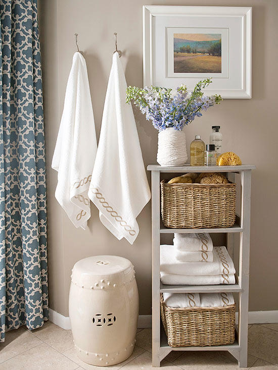 1.SCALE DOWN SHELVES - There is seldom ample space for large furniture or fixtures in small bathrooms. That is why scaling down on your furniture's size is a good idea. This simple three-tiered shelving unit is a great way to discreetly store necessities such as toiletries, grooming products, and extra towels in an organized manner. Additionally, there's something to be said for the rule of 3. People tend to be more visually engaged when they see groups of three items, so take advantage of this and dive into this triple-shelf trend!