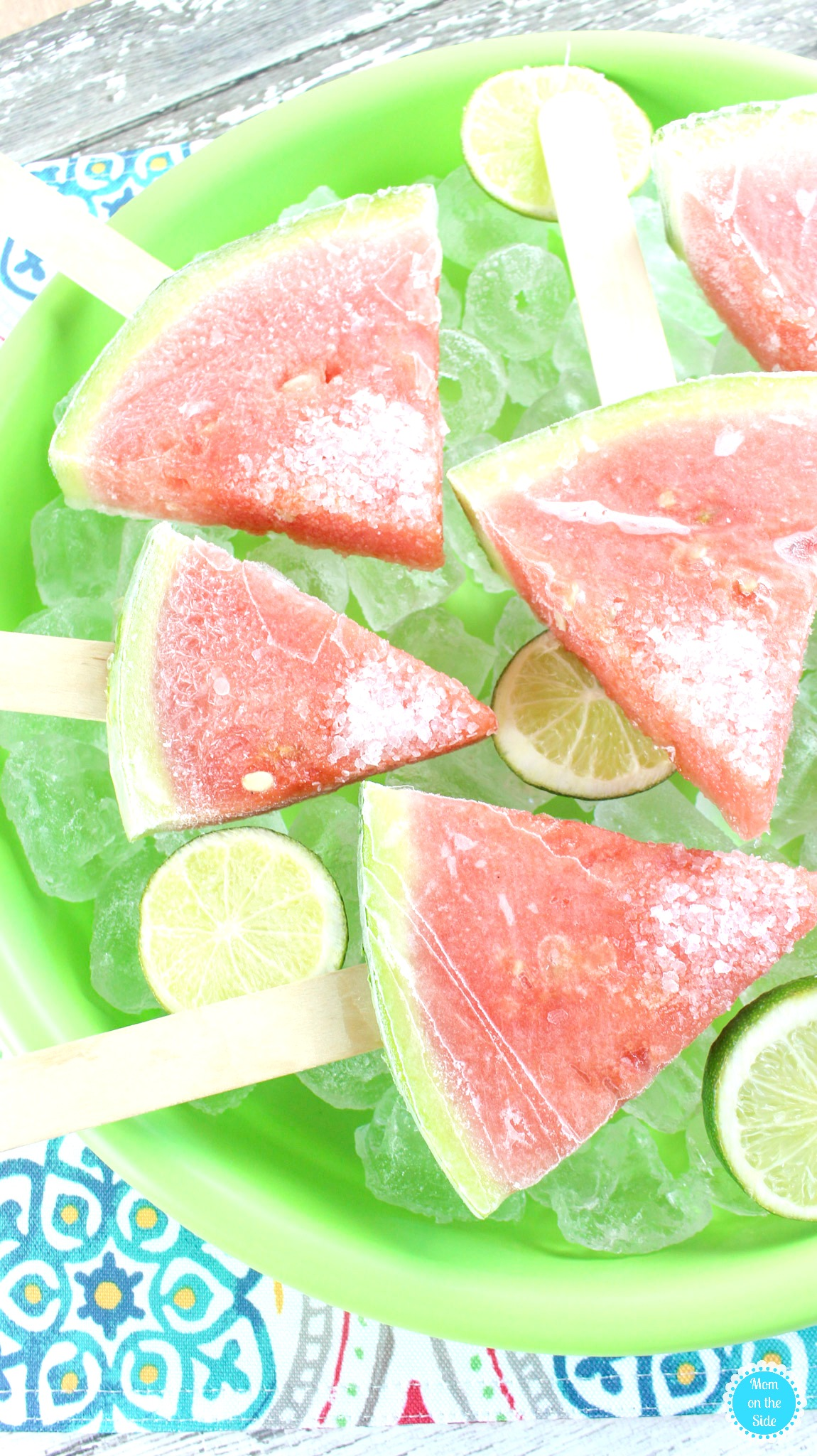 BOOZY WATERMELON POPS - INGREDIENTS6-8 seedless watermelon wedges1 cup sugar3/4 cup boiling water4 Tablespoons lime juice (juice of 2 limes)1/2 cup tequila1/4 cup triple secMargarita Salt (affiliate link)See it here!