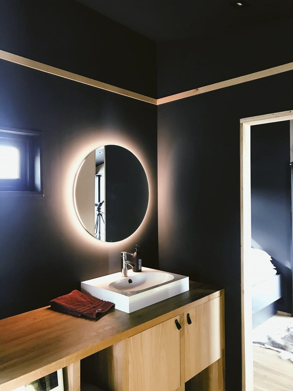 3. Get Reflective With Mirrors - Mirrors don't just show you what you can't see on your own face. They can also brighten and expand the look and feel of your room. Adding a simple wall mirror to your bathroom will give it a fresh, more spacious appearance. Try hanging an oval mirror over a VIGO vessel bathroom sink and just watch as the water reflects upwards. Both round and square mirrors have their benefits, so think about what you like best and where your priorities lie. Are you looking to maximize space or focus on artistic dimension? To really make the most of the layout you're working with, try to find a mirror that offers backlighting so you can have a two-in-one situation.Image source: Julie Aagaard