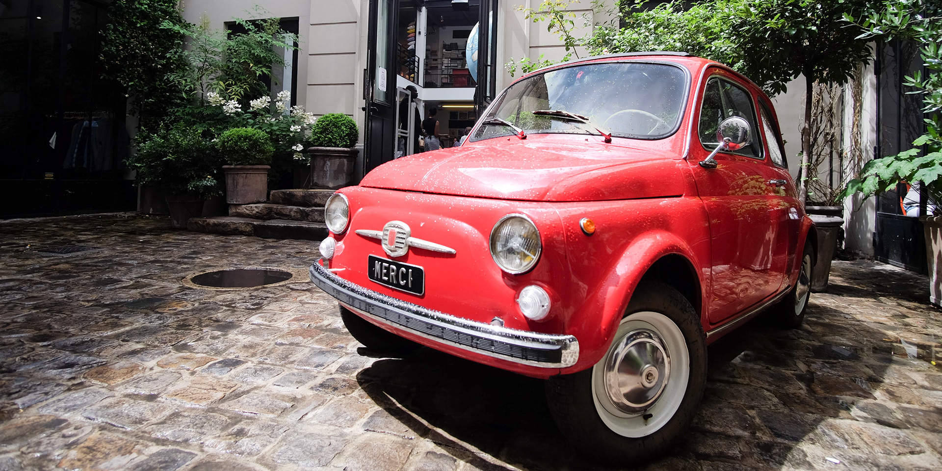 The iconic red Fiat at the entrance to Merci (photo by  Tony )