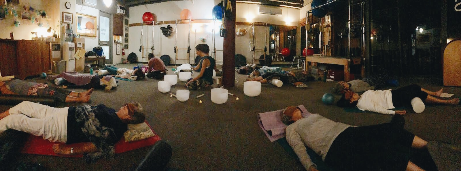 Students enjoy the benefits of acupuncture as they soak in a relaxing sound bath.