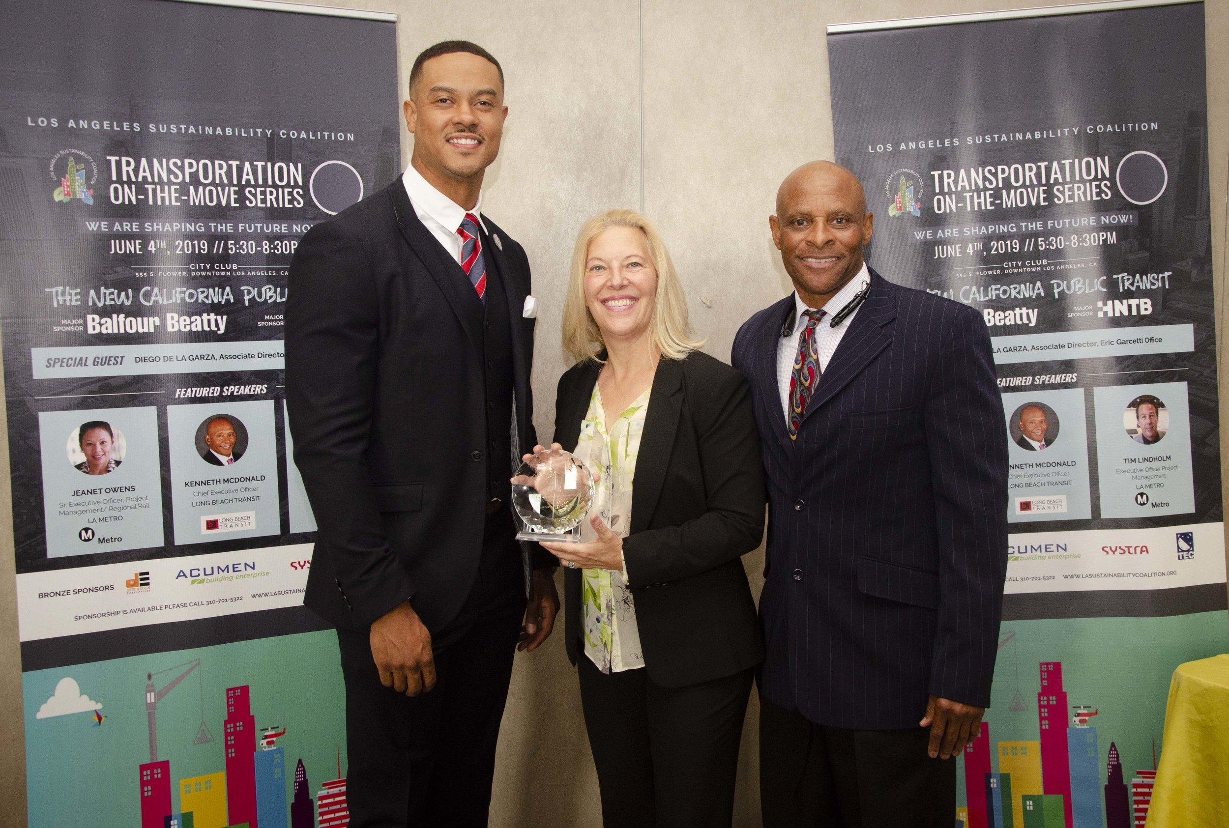 Marcy Szarama  and  James Penn  receiving an award st LASC event 6/4/19
