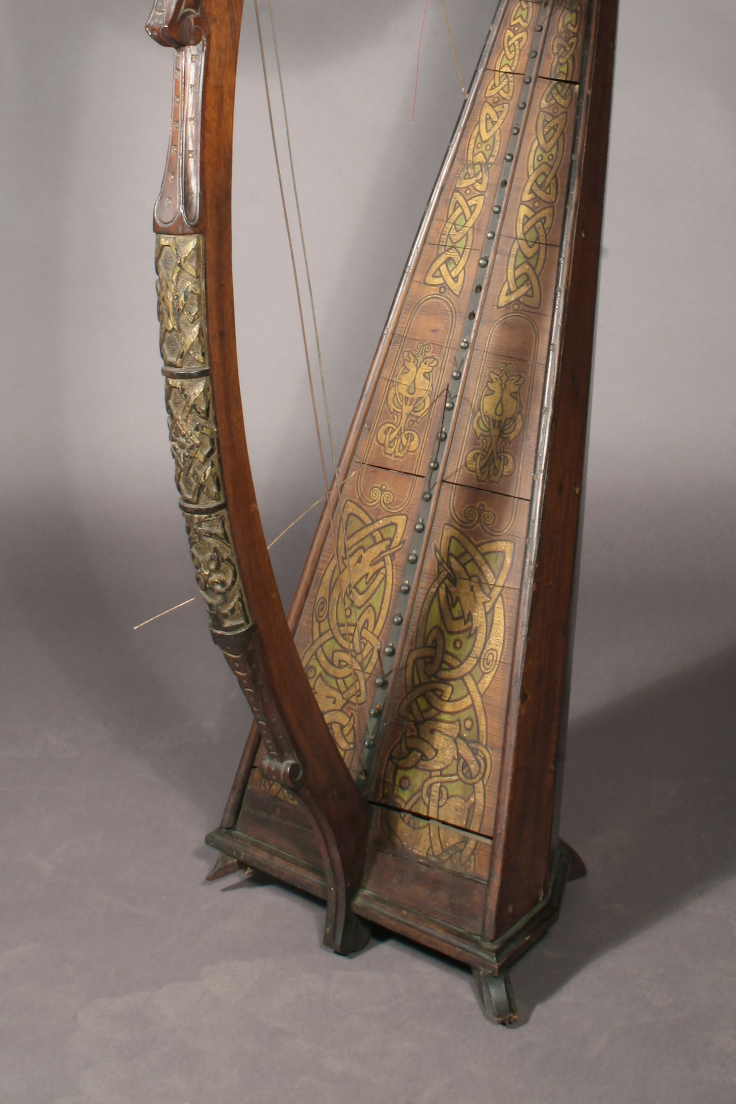 Before treatment: Detail of an Irish-inspired polychrome historic harp from the studio of American harp maker Melville Clark