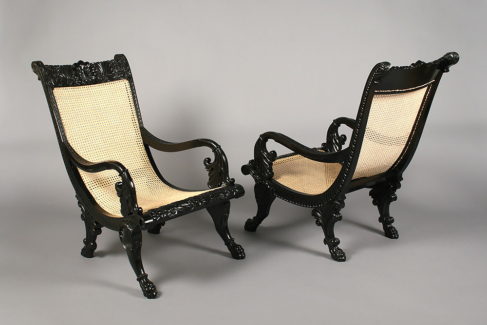 Ebony arm chairs with restored caned seating