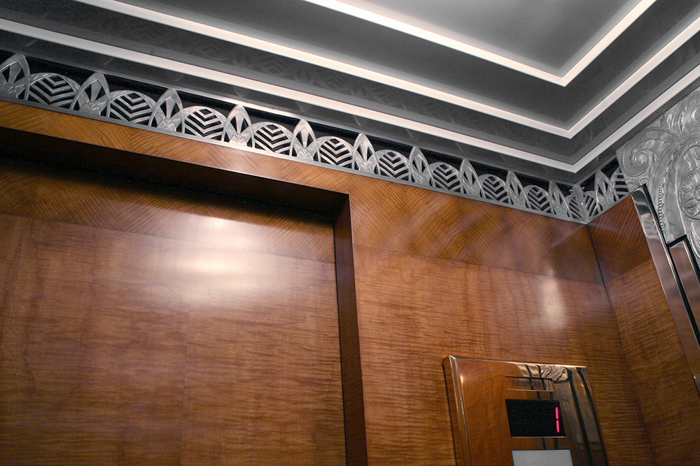Art Deco elevator cab within Chicago's Powhatan Apartments after restoration by Bernacki & Associates