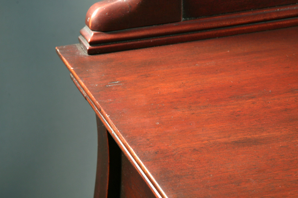 Top surface after infilling and stabilizing veneer then restoring finish in a manner close as possible to the original