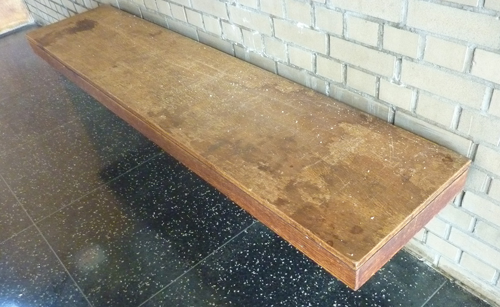 Veneered bench onsite before restoration
