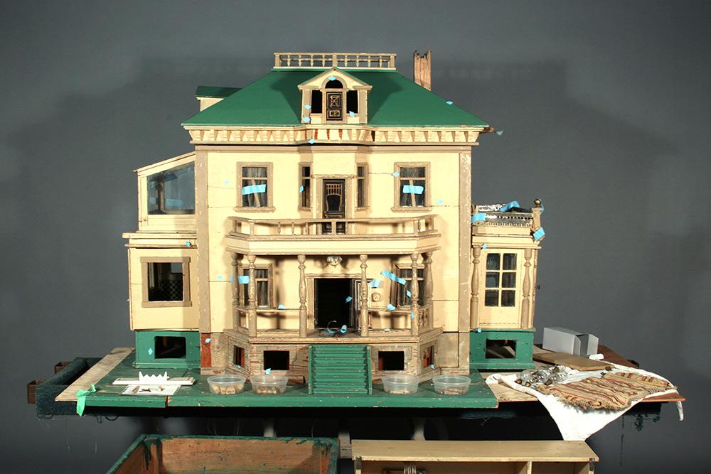 Photo:  Historic dollhouse exterior before restoration