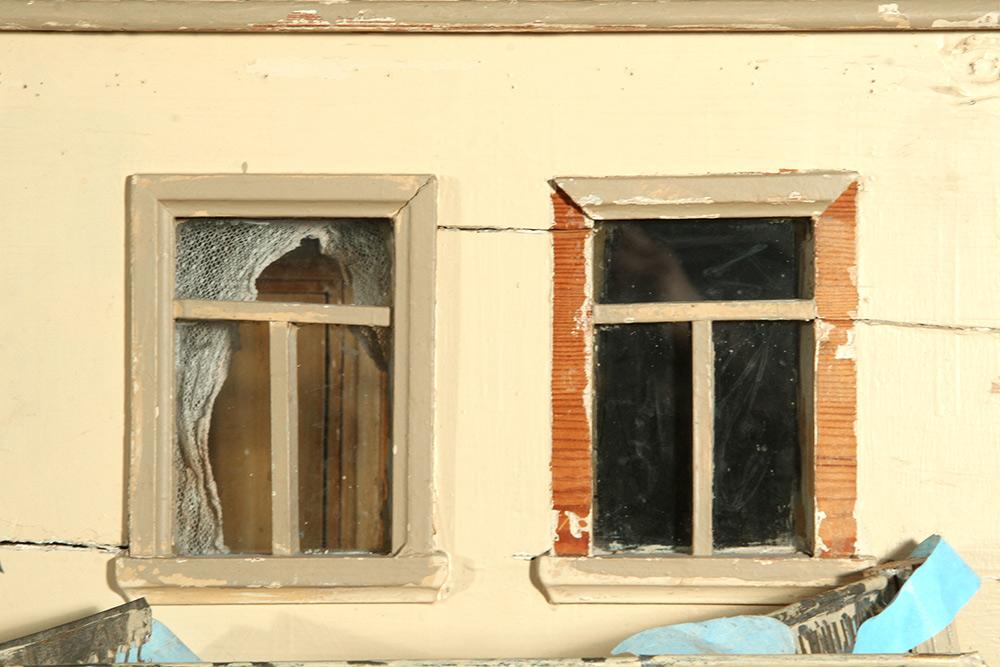 Photo:  Dollhouse detail before restoration