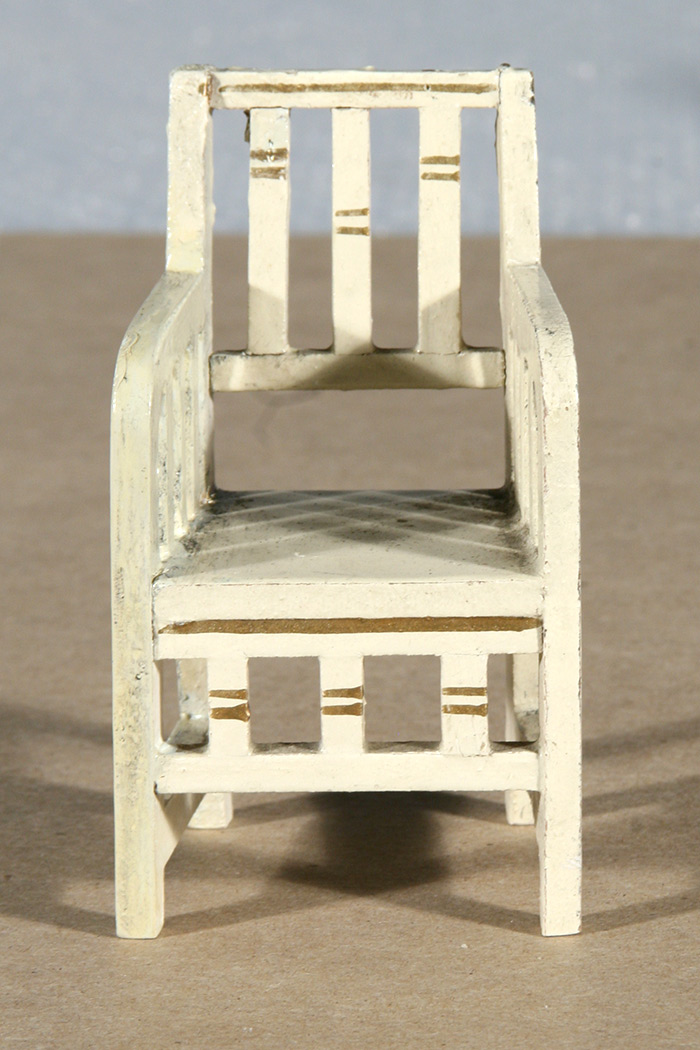 Photo:  Dollhouse chair after being restored